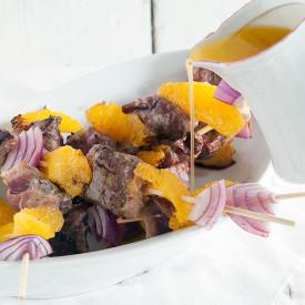 Duck kebab with orange butter sauce